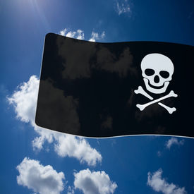 pic of skull crossbones flag  - Pirate Black Flag with white Skull and Crossbones sign on blue sky background - JPG