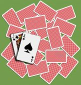 stock photo of ace spades  - Black Jack Ace Spades blackjack hand playing card backs shuffled on casino table - JPG