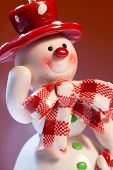 Cheerful snowman on a red background.
