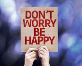 Don't Worry Be Happy written on colorful background with defocused lights
