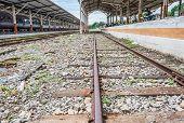 Railway Lines Travel Through A Railway Station