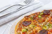 Delicious Pizza And Silverware