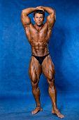 Athletic Sports Bodybuilder Demonstrates Posture