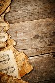 image of compose  - Vintage music notes on the wooden background - JPG