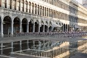 Puddle Which Reflects Procuratie Vecchie In Piazza San Marco In Venice
