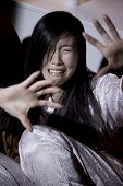 Scared Asian Woman Crying About Domestic Violence