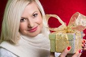 A Girl In A White Sweater With A Gift Bow With Bandaged Looking At The Camera