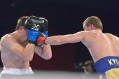 NOVOSIBIRSK, RUSSIA - NOVEMBER 29, 2014: Match Boris Georgiev (left) of Bulgaria vs Viacheslav Kislitsyn of Ukraine during AIBA Pro Boxing tournament. The winners will go to the Olympics-2016