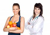 Young Pretty Girl With Many Fruits And Nutritionist