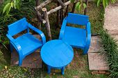 Blue Table And Chairs In A Garden