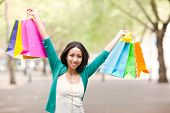 picture of mixed race  - A shopping black woman carrying shopping bags outdoor - JPG