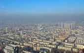 stock photo of smog  - Residential areas in Harbin in smog China - JPG