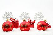 Red Christmas Gifts And Baubles With Snowflakes On Snow