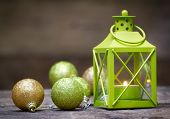 Christmas lantern with decorations over wooden background