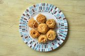 image of baklava  - Birds nest baklava dessert with peanuts on wooden table - JPG