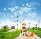 Three-dimensional worker standing on road running through green hills. Cooling towers and cranes as