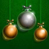 Christmas silver and golden realistic shiny glass baubles on green background