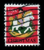 Child On Rocking Horse. Christmas Postage Stamp