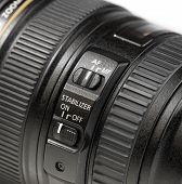 image of stability  - close up stabilizer button on photo camera lens - JPG