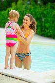 Happy Mother And Baby Girl At Poolside