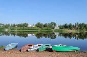 Row Boats On Riverbank