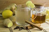 Ginger Tea And Ingredients Like Ginger Itself, Lemon, Honey, Cinamon