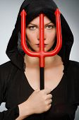 Halloween concept with woman holding pitchfork