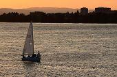 pic of portland oregon  - Small sailboat tacking back into port on the Columbia River near Portland Oregon at sunset - JPG