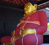 Large Buddha in red apparel.