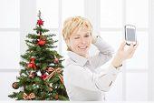 Business woman take self photo and christmas tree