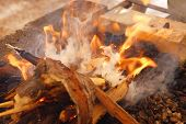 wooden bonfire on bbq as background