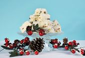 Christmas Holiday Traditional White Christmas Confectionery Chocolate Against Pale Blue And White Ba