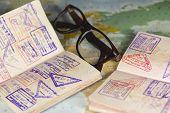 Passports,glasses,map