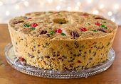 image of pecan  - Traditional light fruitcake decorated with pecans and cherries - JPG