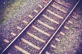 Retro Filtered Photo Of Railway Tracks Background.