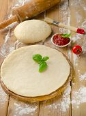 Pizza Dough On A Wooden Board
