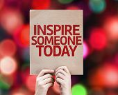 Inspire Someone Today written on colorful background with defocused lights