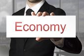 Businessman Showing Sign Economy