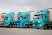 Three Turquoise Trailer Trucks