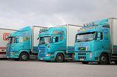 Three Turquoise Trailer Trucks