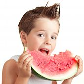 Happy four years old boy smiling with watermelon, isolated on wh