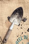 Gardening Tools with Soil On Sack Background