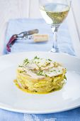 stock photo of cod  - Salted cod fish oven baked with potatoes onion and olive oil - JPG