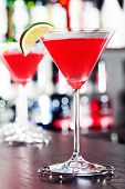 picture of cosmopolitan  - Two Cosmopolitan cocktails shot on a bar counter - JPG
