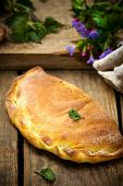 stock photo of nettle  - calzone with ricotta and nettle - JPG