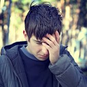 picture of sorrow  - Toned Photo of Sorrowful Young Man outdoor - JPG