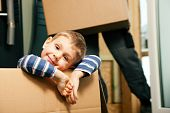 stock photo of movers  - Family moving in their new home - JPG
