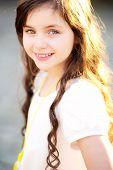 stock photo of fascinating  - Fascinating little girl smiling half - JPG