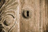 image of wooden door  - Fragment of old wooden door with a key lock on the door - JPG