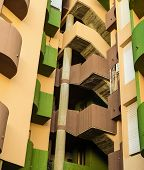 stock photo of high-rise  - Colorful high rise building facade with curved lines - JPG
